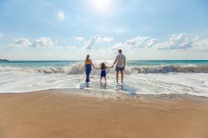 parents child at beach natalya zaritskaya