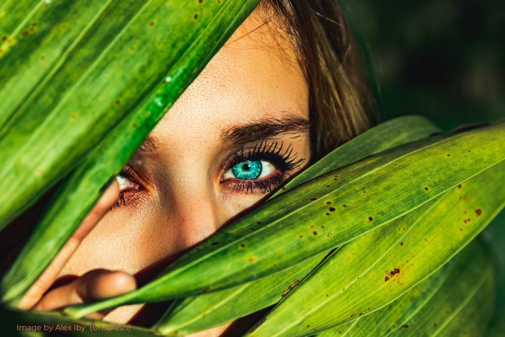 Woman Green Eyes Hiding Behind Plant