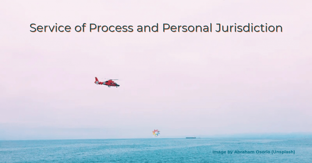 Red helicopter in mid air above sea. Corporate and Trust Challenges to Service of Process and Personal Jurisdiction